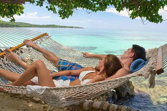 a couple enjoying beach time on their honeymoon in Jamaica