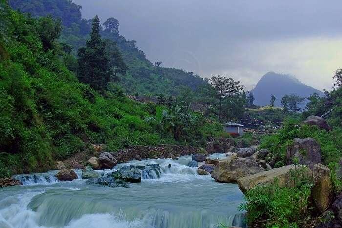take a refreshing dip at Sahastradhara