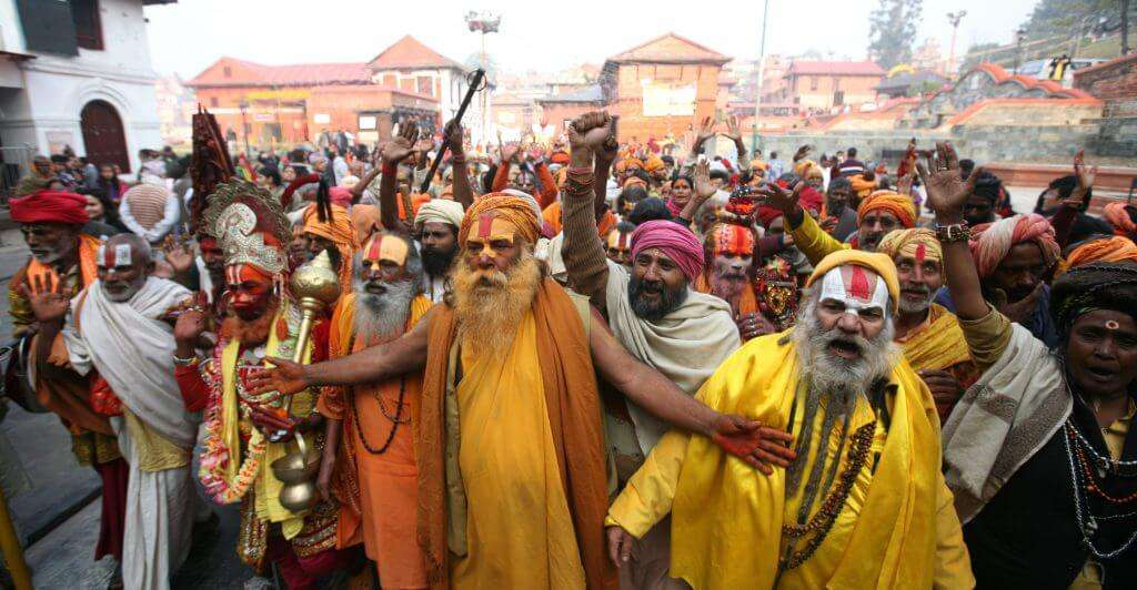 priests celebrating festival wearing traditional clothes