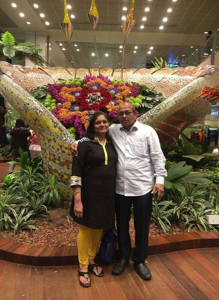 saurabhi singapore family trip: parents posing in the cruise