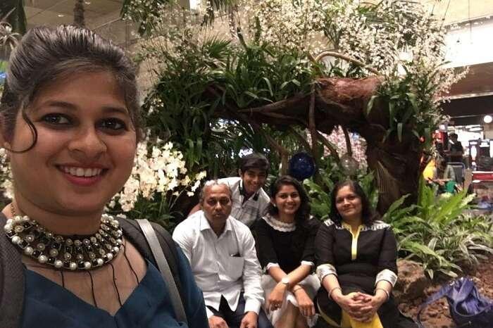 saurabhi singapore family trip: saurabhi with parents posing in the cruise