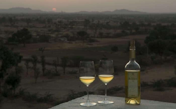 Wine glasses and bottle in Lakshman Sagar Resort