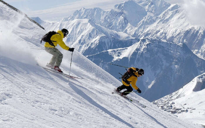 Skiing in Auli's snow filled hill station, an adventure destination