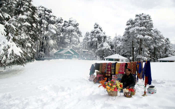 shopkeeper during snowfall in Kashmir