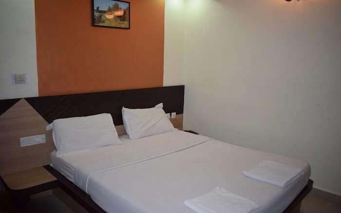 A hotel room in Pondicherry with akind size bed