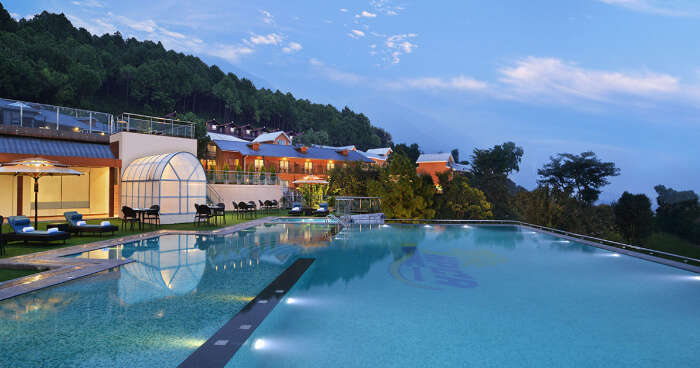 a swimming pool in a hotel in mountains