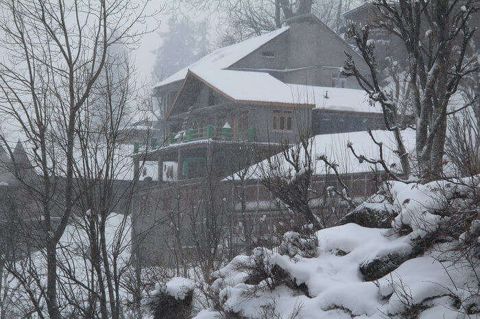 snow covered house in mountains