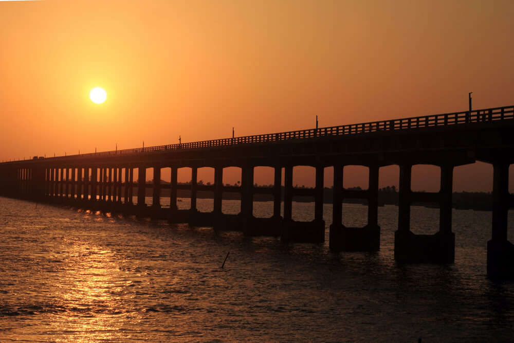 a bridge on water during sunset