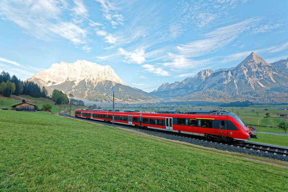 a red train in Swiss alps