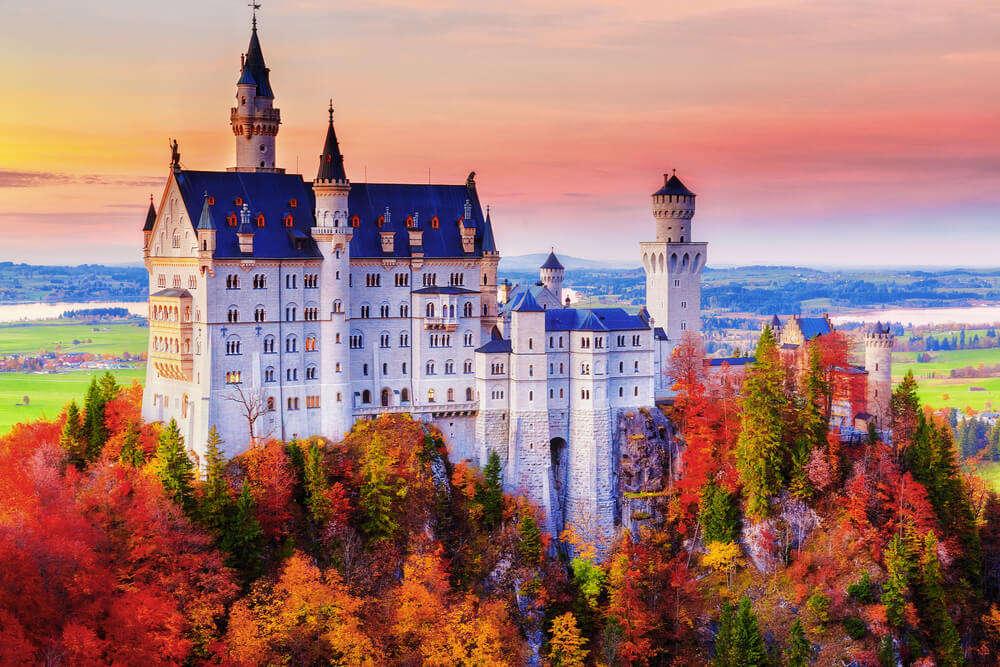 a gorgeous castle amid colourful trees