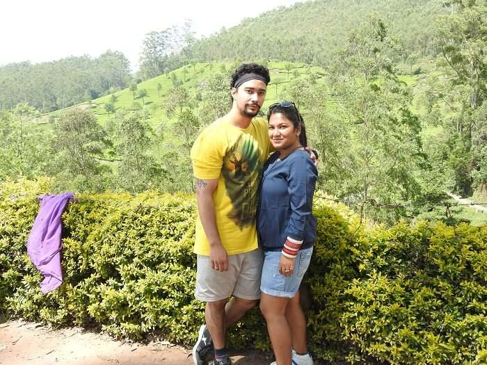 pooja and her husband at tea garden in munnar