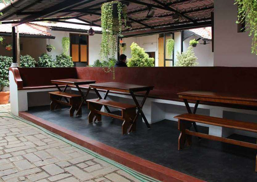 wooden seating in Duy Art Cafe