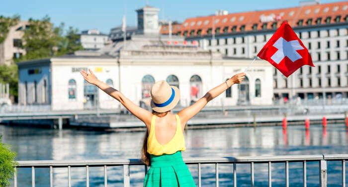 a girl holding Switzerland flag