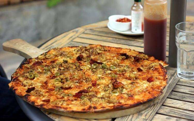 Pizza on table in Glens Bakehouse
