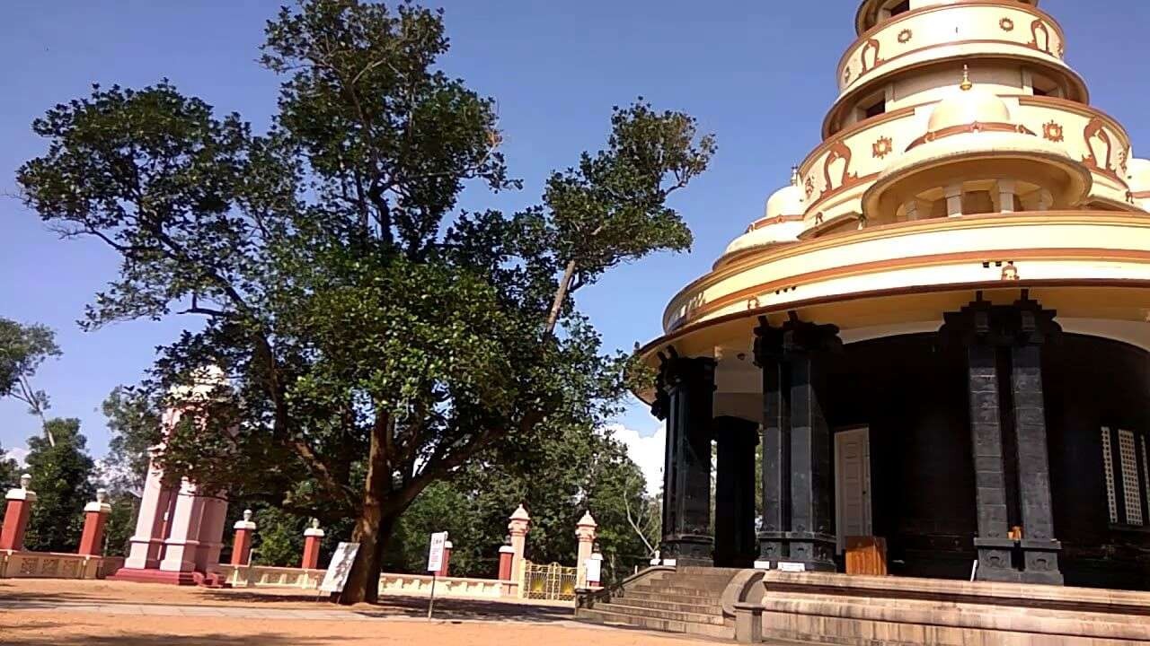 a huge temple with many trees around
