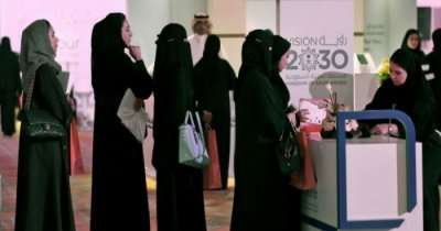 Female travelers in Arabia at the ticket counter on airport