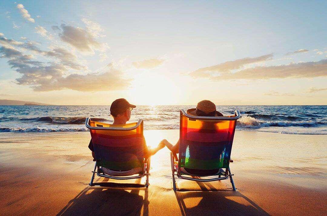 a couple sitting on beach