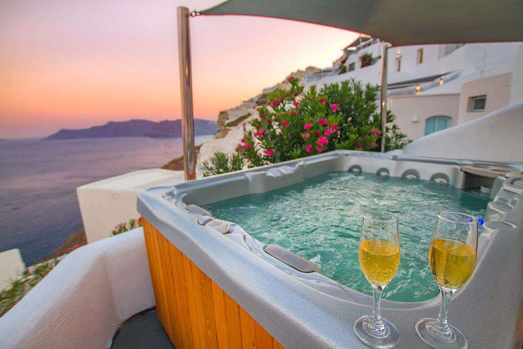 a hot pool with a glass of alcohol