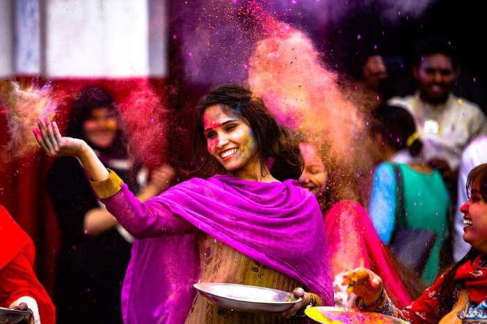 A woman playing Holi
