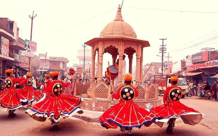 Rajasthani men dancing on the eve of Holi