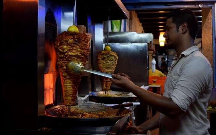 A man preparing Shawrma in Panji in Goa