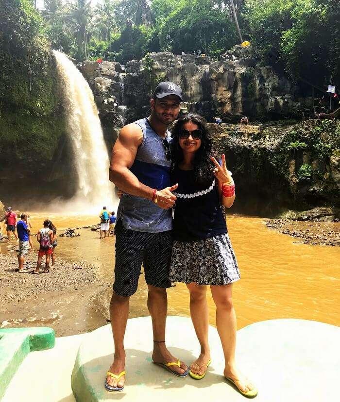 Couple near waterfall in Bali