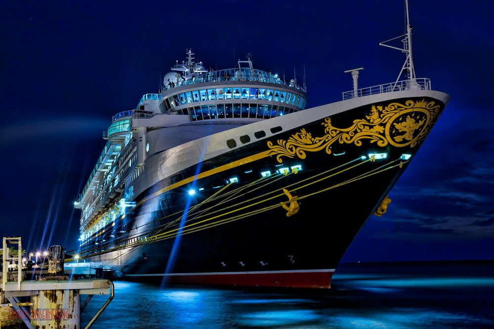 a disney cruise line at night