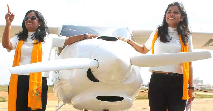 mother daughter with a light aircraft
