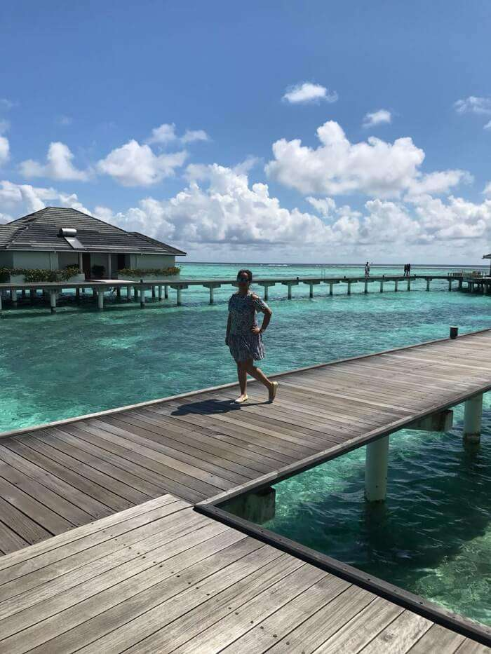 nihals wife in front of the water villa