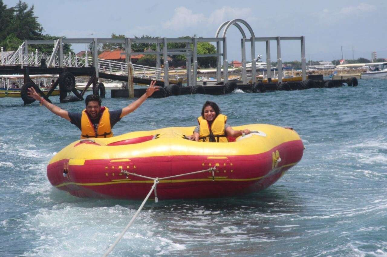 tushar honeymoon trip to Bali: tushar & wife enjoying tube ride