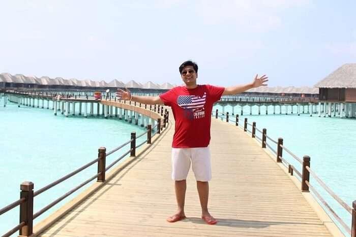 ankit wadhwa maldives honeymoon: posing near water villas