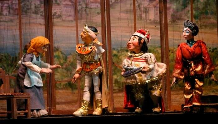 Watch a puppet show, or buyone from a shop