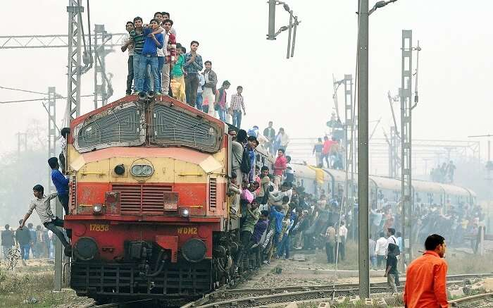 People standing on top of a train in India