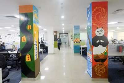 A view of the business bay at TravelTriangle with painted pillars