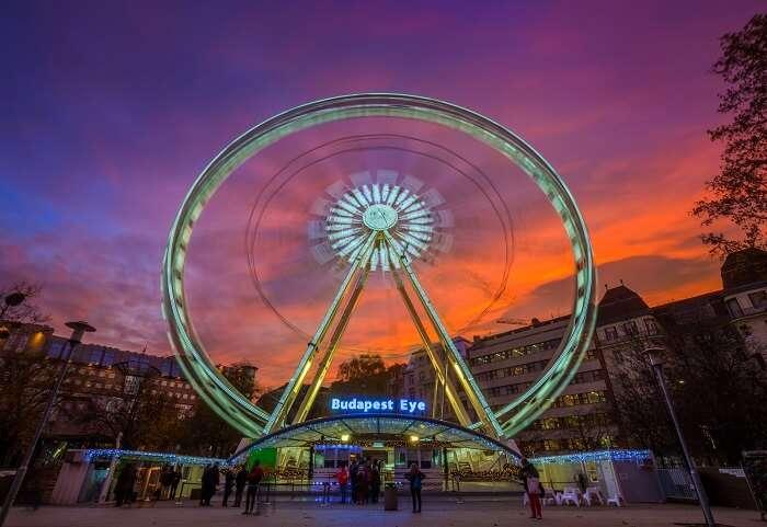 Enjoy a ride on the lit Budapest Eye Ferris Wheel hungary