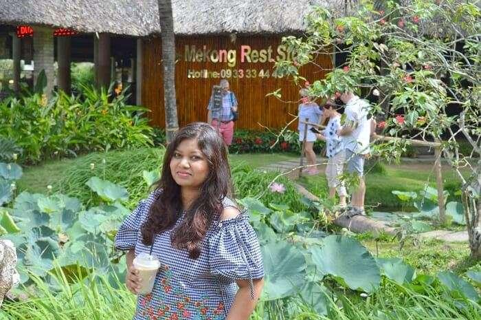 pallavi vietnam family trip: standing near mekong rest stop