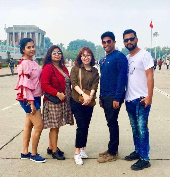 pallavi vietnam family trip: posing outside palace