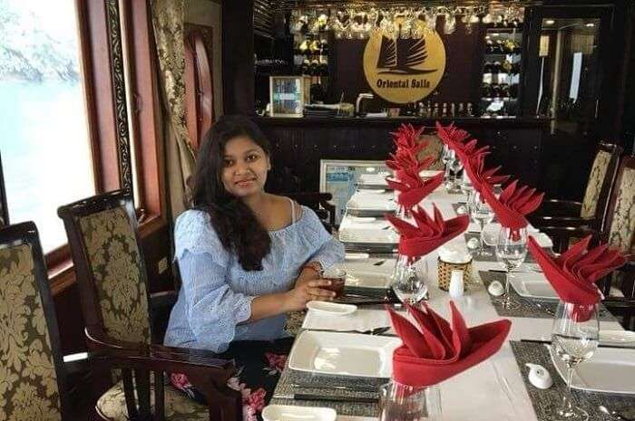 pallavi vietnam family trip: while dining at restaurant in cruise