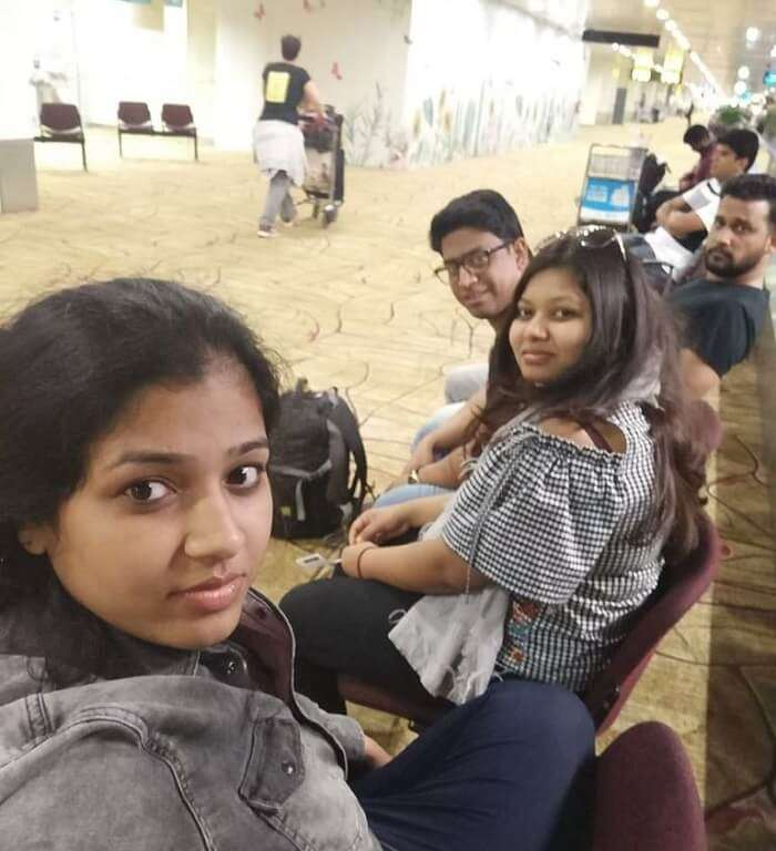pallavi vietnam family trip: dining at airport groupfie