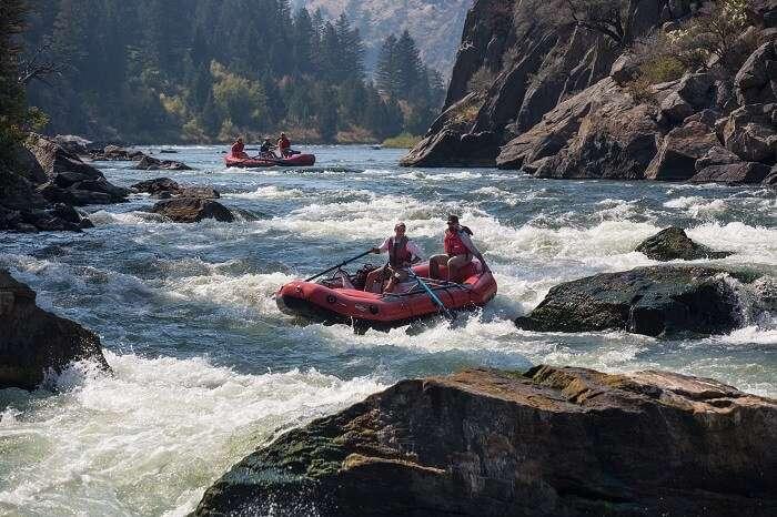Tourists enjoying White Water Rafting