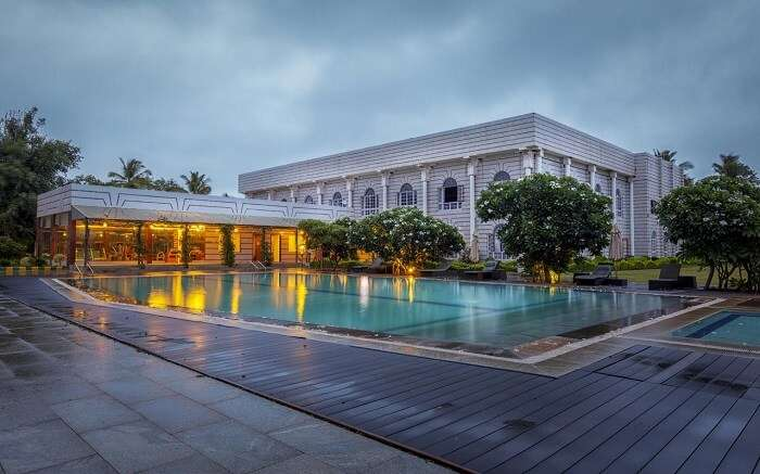 a luxurious hotel with a huge outdoor pool ss01052018