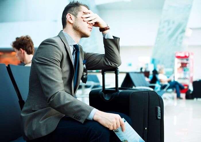 flight delayed stressed man