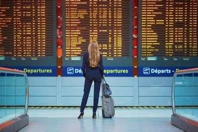 a woman checking flight status at airport