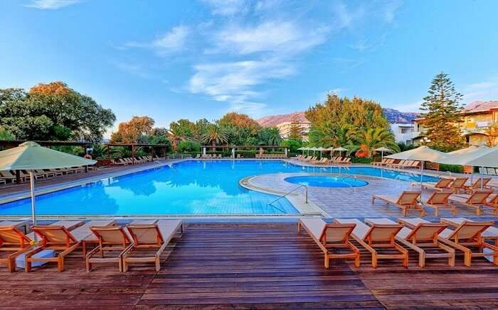 an outdoor pool with wooden sundecks around it 1 ss18062018