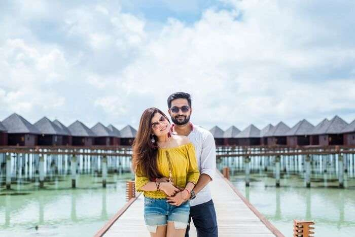 couple posing in front of villa