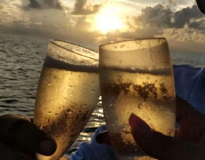 couple holding wine glasses