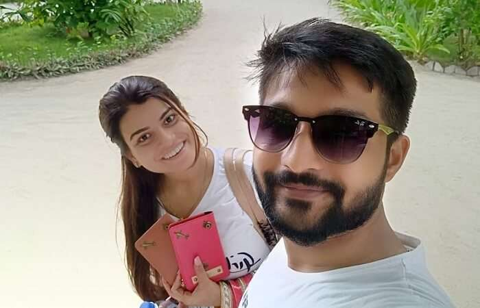 couple with passports in maldives