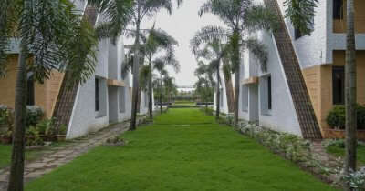 a lush lawn of a Belgaum resort