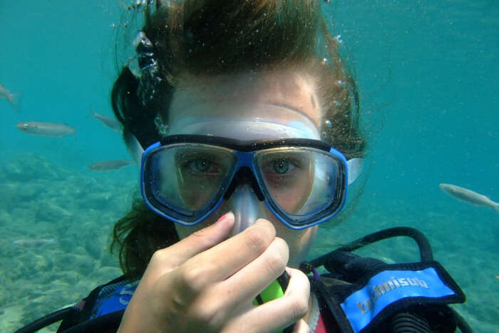 A diver holding her breathe under water
