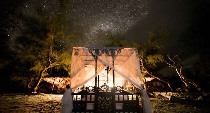 Four poster bed underneath the stars